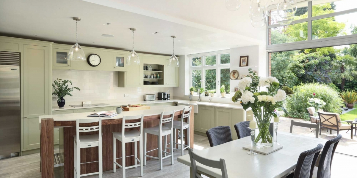 Family kitchen and dining area.  Kitchen design by Greengage Kitchens.